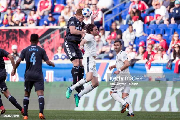 Tim Parker of New York Red Bulls and Alan Gordon of Chicago Fire challenge for the ball during the New York Red Bulls Vs Chicago Fire MLS regular...