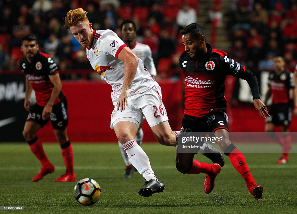 Tim Parker (L) of New York Red Bulls and Mateus Goncalves (R) of Tijuana compete for the ball during the quarter finals first leg match between Tijuana and New York RB at Caliente Stadium on March 06, 2018 in Tijuana, Mexico.