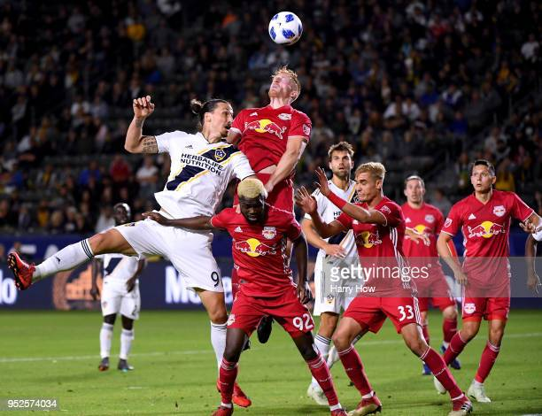 Tim Parker of New York Red Bulls clears a cross from Zlatan Ibrahimovic of Los Angeles Galaxy during the second half of a 32 Red Bulls win at StubHub...