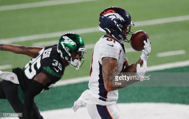 Tim Patrick of the Denver Broncos catches a pass for a touchdown against Pierre Desir of the New York Jets during the third quarter at MetLife...