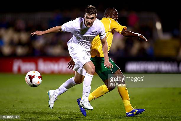 Tim Payne of New Zealand is tackled by Hlompho Kekana of South Africa during the International Friendly match between the New Zealand All Whites and...