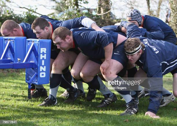 Tim Payne who will replace the injured Andrew Sheridan packs down with fellow front row Mark Regan and Phil Vickery during England rugby training at...