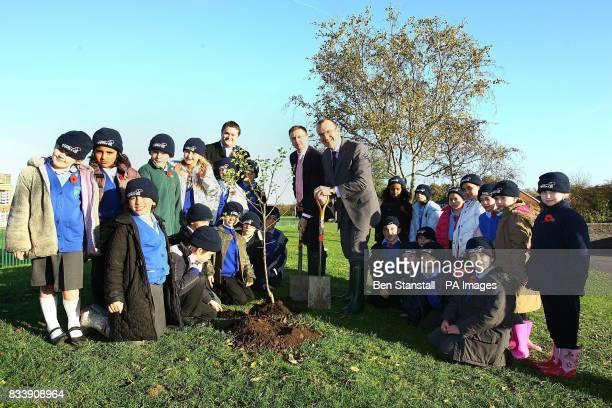 Tim Pearson CEO of RM Computers left and Sir Terry Leahy CEO of Tesco plant trees with pupils of Brookland Junior School in Cheshunt to create a new...