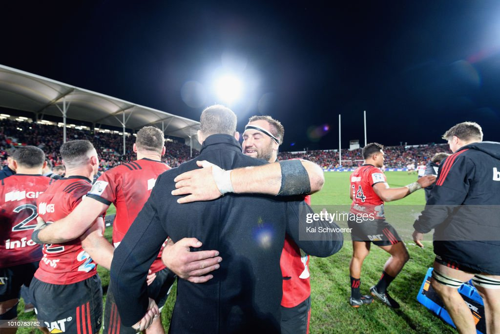 Tim Perry hugs Wyatt Crockett of the Crusaders after their win in the Super Rugby Final match between the Crusaders and the Lions at AMI Stadium on August 4, 2018 in Christchurch, New Zealand.