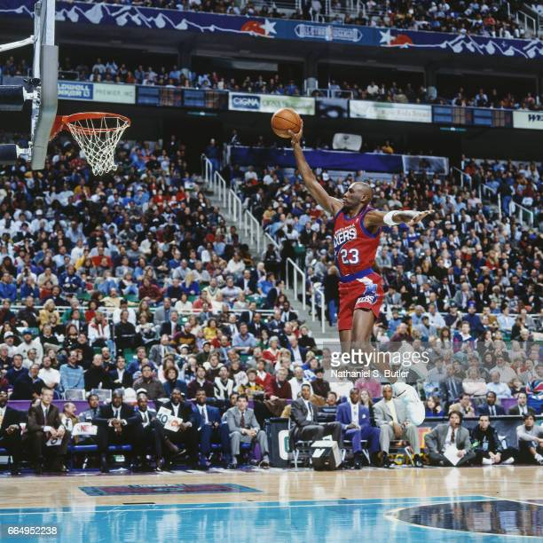 Tim Perry of the Philadelphia 76ers attempts a dunk during the 1993 NBA Slam Dunk Contest on February 20 1993 at the Delta Center in Salt Lake City...