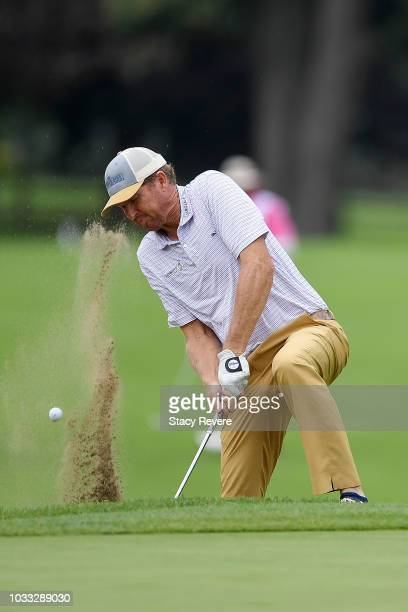 Tim Petrovic hits from a green side bunker on the first hole during the first round of the Ally Challenge presented by McLaren at Warwick Hills Golf...