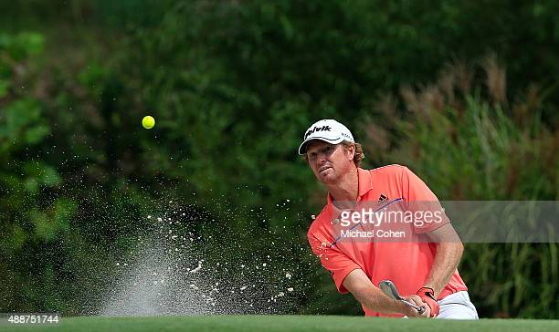 Tim Petrovic hits his second shot on the eighth hole from a bunker during the first round of the Small Business Connection Championship at River Run...