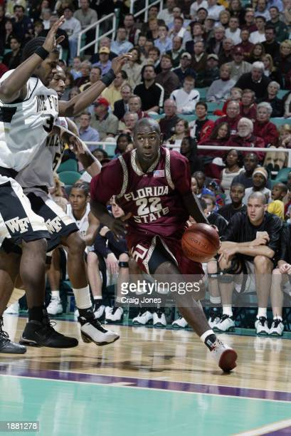 Tim Pickett of Florida State drives to the basket during the quarter final game of the ACC Tournament against Wake Forest on March 14 2003 at the...