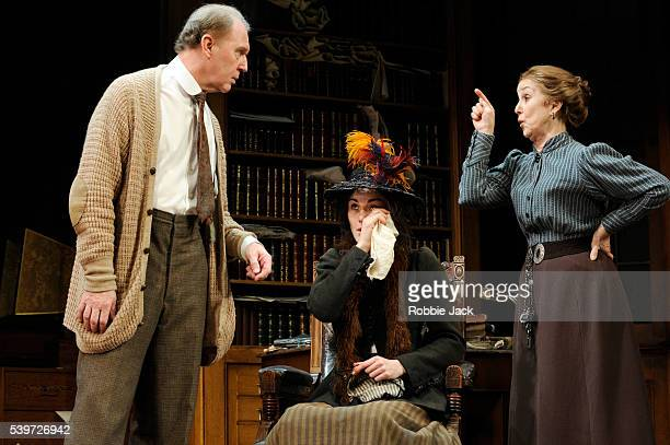 Tim PigottSmith Michelle Dockery and Una Stubbs perform in the production of Bernard Shaw's play Pygmalion at the Old Vic Theatre in London