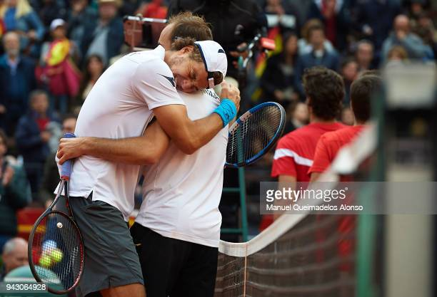 Tim Puetz and JanLennard Struff of Germany celebrate defeating Feliciano Lopez and Marc Lopez of Spain in the doubles during day two of the Davis Cup...
