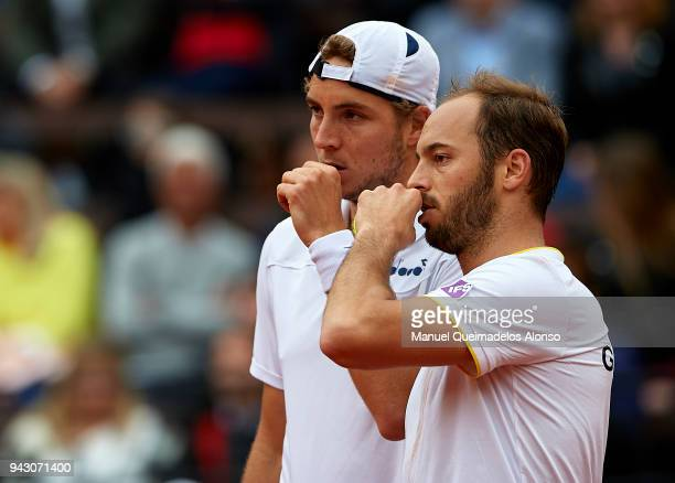 Tim Puetz and JanLennard Struff of Germany talk tactics against Feliciano Lopez and Marc Lopez of Spain in the doubles during day two of the Davis...