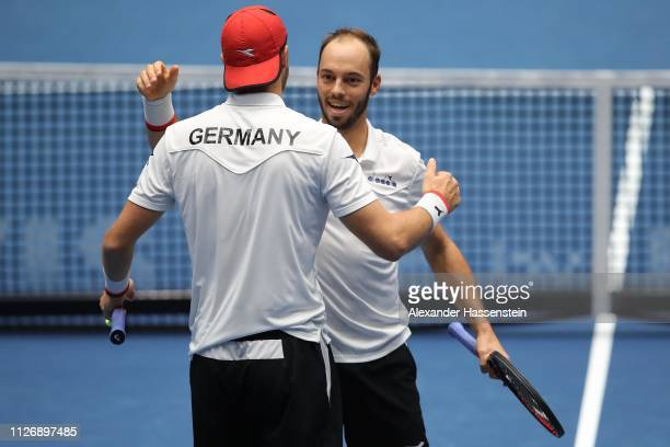 Tim Puetz of Germany and his team mate JanLennard Struff celebrate victory after winning her double match against Gabor Borsos and Peter Nagy of...