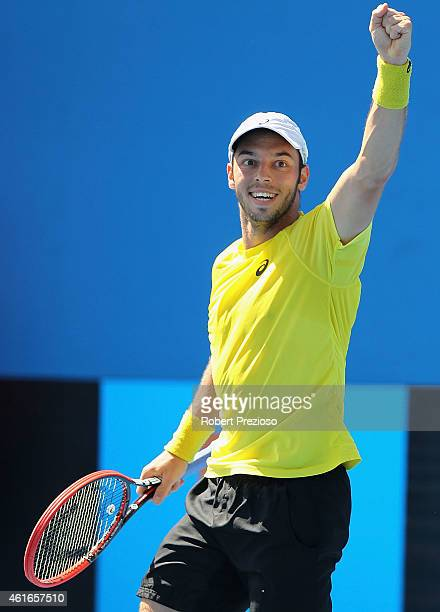 Tim Puetz of Germany celebrates winning in his qualifying match against Jarmere Jenkins of USA for 2015 Australian Open at Melbourne Park on January...