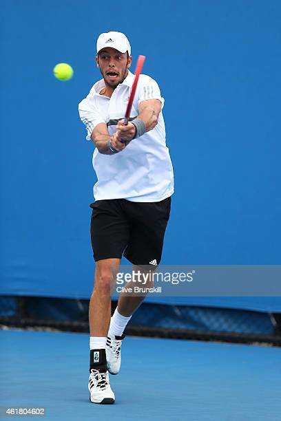 Tim Puetz of Germany plays a backhand in his first round match against Donald Young of the United States during day two of the 2015 Australian Open...