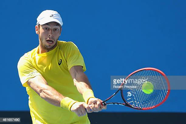 Tim Puetz of Germany plays a backhand in his qualifying match against Jarmere Jenkins of USA for 2015 Australian Open at Melbourne Park on January 17...
