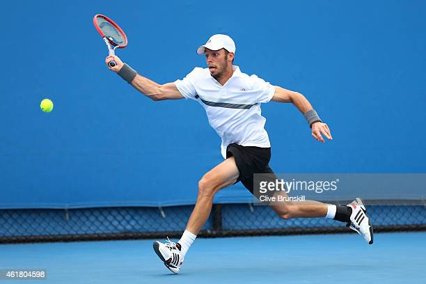 Tim Puetz of Germany plays a forehand in his first round match against Donald Young of the United States during day two of the 2015 Australian Open...