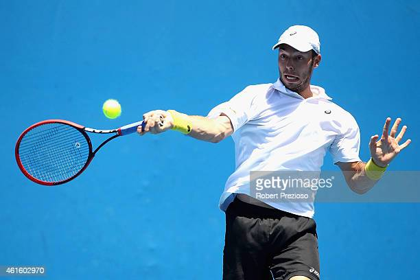 Tim Puetz of Germany plays a forehand in his qualifying match against Damir Dzumhur of Bosnia and Herzegovina for 2015 Australian Open at Melbourne...