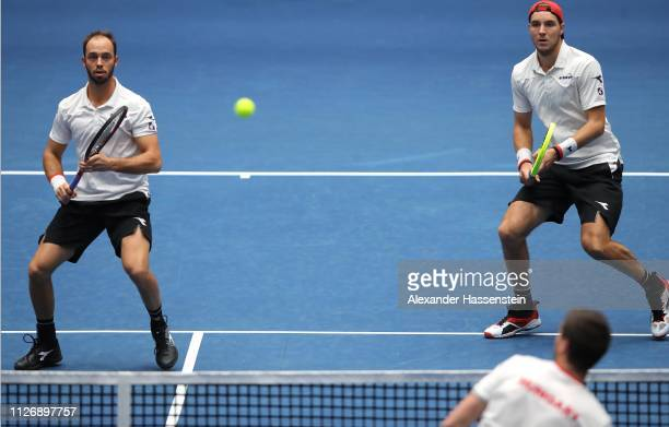 Tim Puetz of Germany plays the ball with team mate Jan-Lennard Struff during her double match against Gabor Borsos and Peter Nagy of Hungary on day...