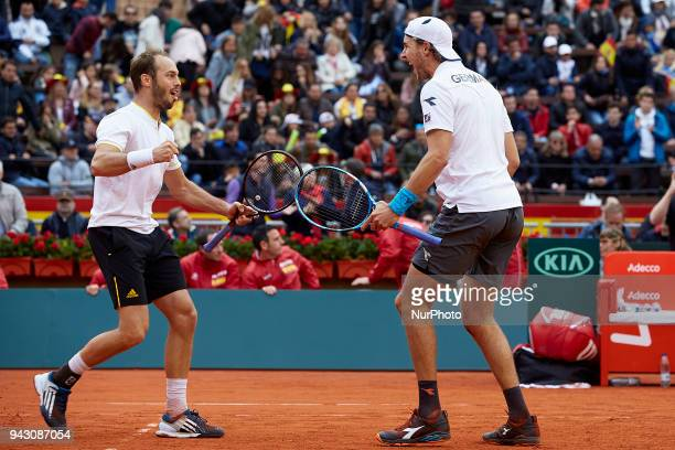 Tim Putz and JanLennard Struff of Germany celebrate the victory in their doubles match against Feliciano Lopez and Marc Lopez of Spain during day two...