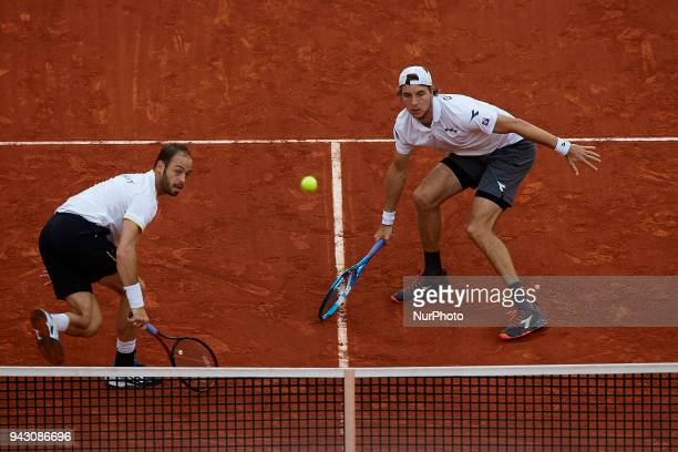 Tim Putz and JanLennard Struff of Germany in action in their doubles match against Feliciano Lopez and Marc Lopez of Spain during day two of the...