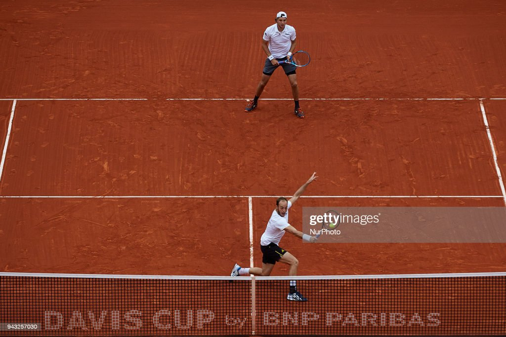 Tim Putz (bottom) and Jan-Lennard Struff of Germany in action in their doubles match against Feliciano Lopez and Marc Lopez of Spain during day two of the Davis Cup World Group Quarter Finals match between Spain and Germany at Plaza de Toros de Valencia on April 7, 2018 in Valencia, Spain