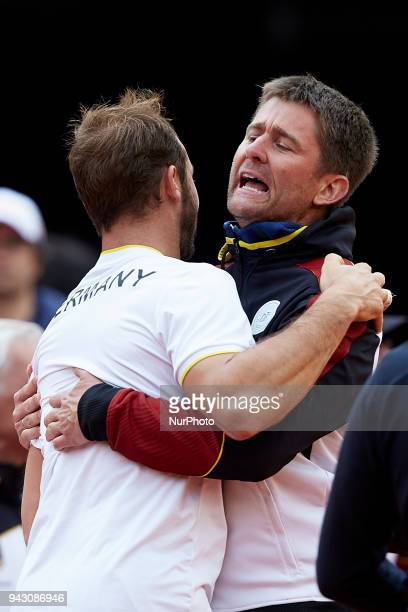 Tim Putz of Germany celebrates the victory with Michael Kohlmann Captain of Germany in his doubles match with JanLennard Struff against Feliciano...