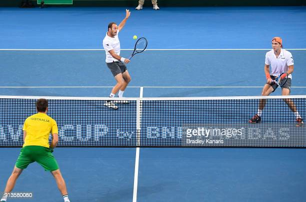 Tim Putz of Germany plays a backhand volley in the doubles match with Jan-Lennard Struff against Matt Ebden and John Peers of Australia during the...