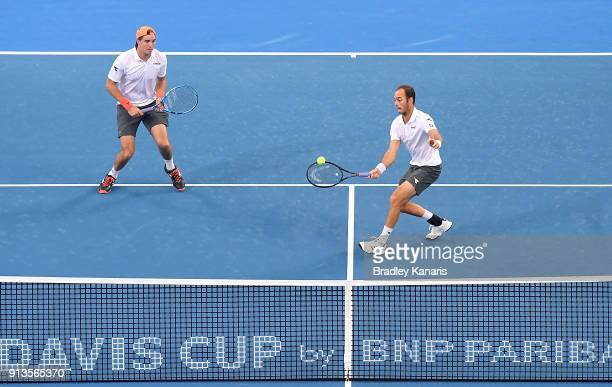 Tim Putz of Germany plays a forehand in the doubles match with JanLennard Struff against Matt Ebden and John Peers of Australia during the Davis Cup...