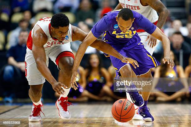 Tim Quarterman of the LSU Tigers fights for the ball against Lennard Freeman of the North Carolina State Wolfpack in the first half during the second...