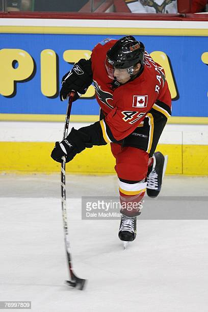 Tim Ramholt of the Calgary Flames moves the puck against the Florida Panthers at the Pengrowth Saddledome on September 16 2007 in Calgary Alberta...
