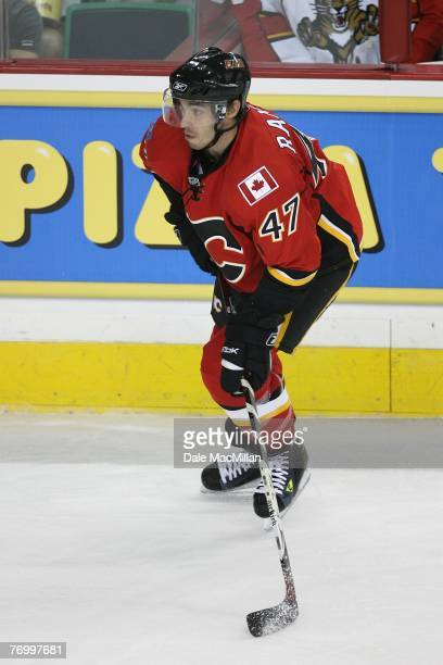 Tim Ramholt of the Calgary Flames skates with the puck against the Florida Panthers at the Pengrowth Saddledome on September 16 2007 in Calgary...