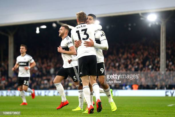Tim Ream and Aleksandar Mitrovic celebrate their first goal an own goal scores by Fernano Llorente during the Premier League match between Fulham FC...