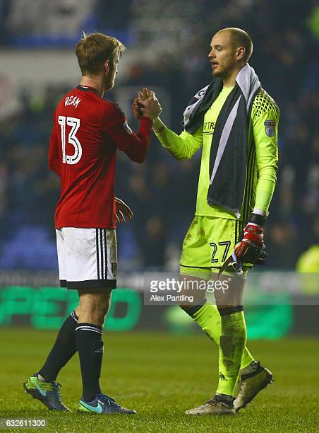 Tim Ream and David Button of Fulham shake hands after defeat in the Sky Bet Championship match between Reading and Fulham at Madejski Stadium on...