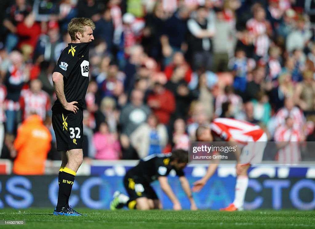 Tim Ream of Bolton Wanderers (L) looks dejected as they are relegated after the Barclays Premier League match between Stoke City and Bolton Wanderers at Britannia Stadium on May 13, 2012 in Stoke on Trent, England.