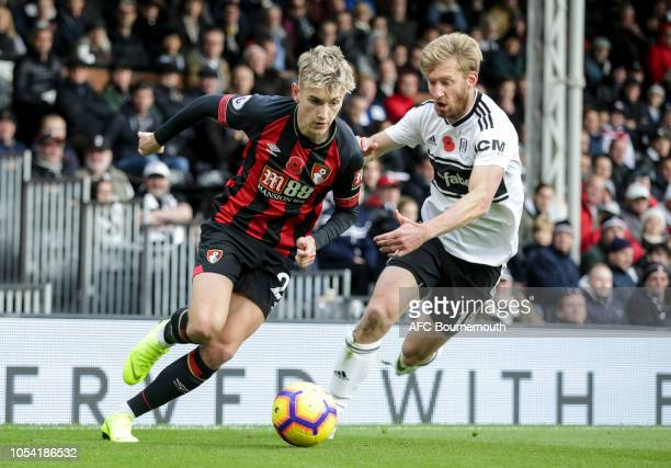 Tim Ream of Fulham and David Brooks of Bournemouth during the Premier League match between Fulham FC and AFC Bournemouth at Craven Cottage on October...