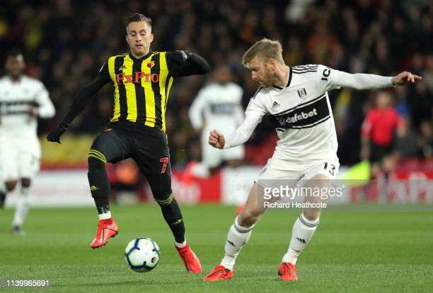 Tim Ream of Fulham is challenged by Gerard Deulofeu of Watford during the Premier League match between Watford FC and Fulham FC at Vicarage Road on...