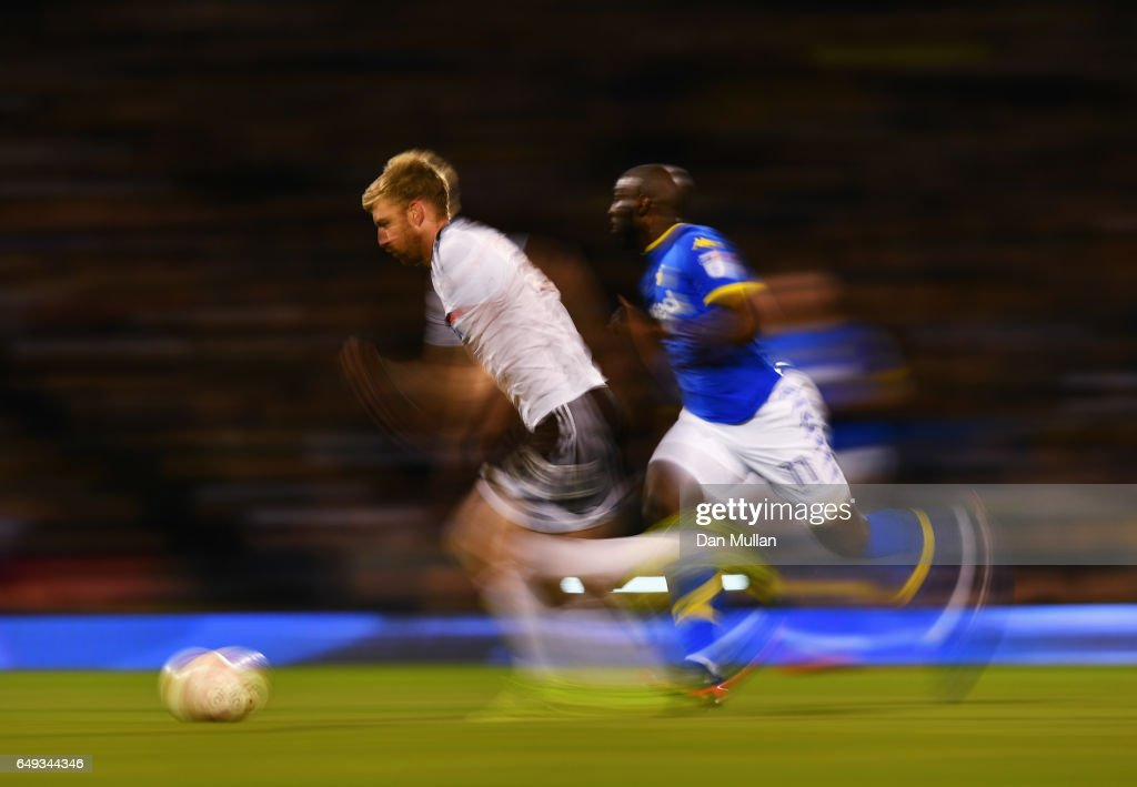 Tim Ream of Fulham is chased by Souleymane Doukara of Leeds United during the Sky Bet Championship match between Fulham and Leeds United at Craven Cottage on March 7, 2017 in London, England.