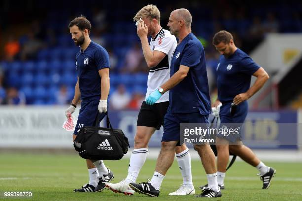 Tim Ream of Fulham leaves the pitch injured during the preseason friendly between Reading and Fulham at the EBB Stadium on July 14 2018 in Aldershot...