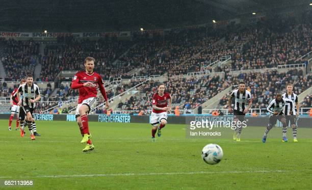 Tim Ream of Fulham misses from the penalty spot during the Sky Bet Championship match between Newcastle United and Fulham at St James' Park on March...
