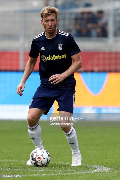 Tim Ream of Fulham runs with the ball during the second semi final match between FC Fulham and Athletic Bilbao at SchauinslandReisenArena on July 28...
