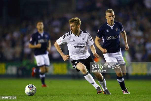 Tim Ream of Fulham runs with the ball during the Sky Bet Championship match between Millwall and Fulham at The Den on April 20 2018 in London England