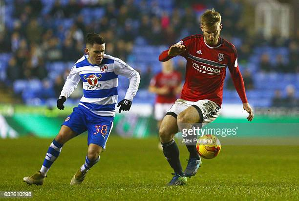 Tim Ream of Fulham shields the ball from Liam Kelly of Reading during the Sky Bet Championship match between Reading and Fulham at Madejski Stadium...