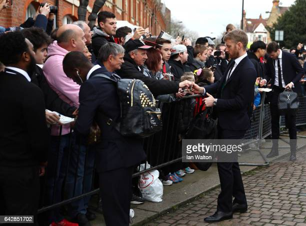 Tim Ream of Fulham signs autographs as he arrives prior to The Emirates FA Cup Fifth Round match between Fulham and Tottenham Hotspur at Craven...