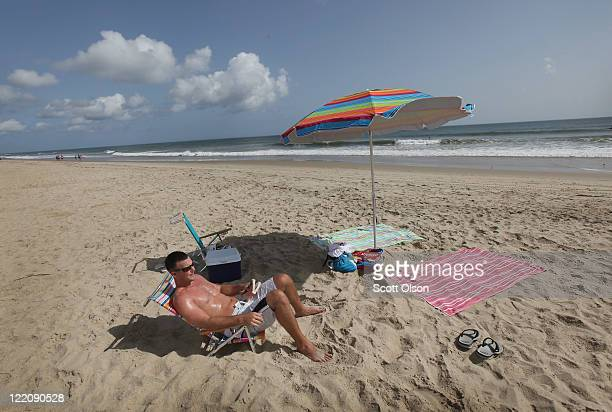 Tim Reilly of Wilmington Delaware relaxes on a nearly empty beach along North Carolina's Outer Banks August 25 2011 in Nags Head North Carolina Dare...