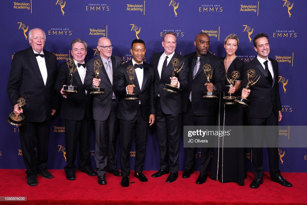 Tim Rice, Andrew Lloyd Webber, Neil Meron, John Legend, Mike Jackson, Ty Stiklorius, and Alex Rudzinski, winners of the the award for outstanding variety special for 'Jesus Christ Superstar Live in Concert' pose in the press room during the 2018 Creative Arts Emmy Awards at Microsoft Theater on September 9, 2018 in Los Angeles, California.