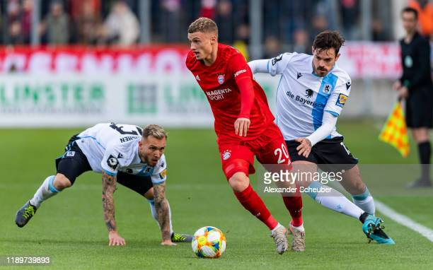 Tim Rieder of 1860 Muenchen and Dennis Erdmann of 1860 Muenchen in action against Michael Cuisance of Bayern Muenchen II during the 3. Liga match...