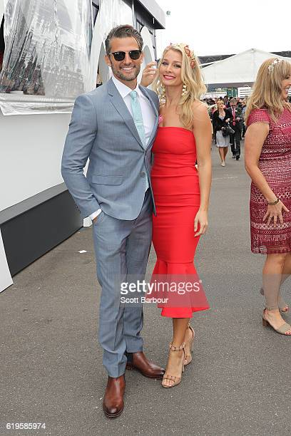 Tim Robards and Anna Heinrich pose at the Birdcage on Melbourne Cup Day at Flemington Racecourse on November 1 2016 in Melbourne Australia