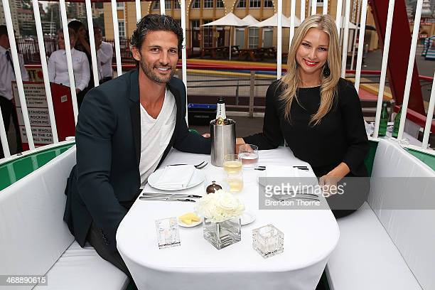 Tim Robards and Anna Heinrich pose inside a ferris wheel cabin during Luna Park's 2014 Valentine's event at Luna Park on February 12 2014 in Sydney...