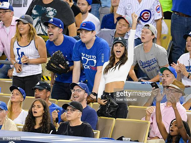 Tim Robbins Jeff Magid and Emily Ratajkowski attends game 5 of the NLCS between the Chicago Cubs and the Los Angeles Dodgers at Dodger Stadium on...