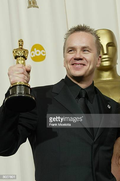 Tim Robbins poses backstage with the award for Best Performance by an Actor in a Supporting Role during the 76th Annual Academy Awards at the Kodak...